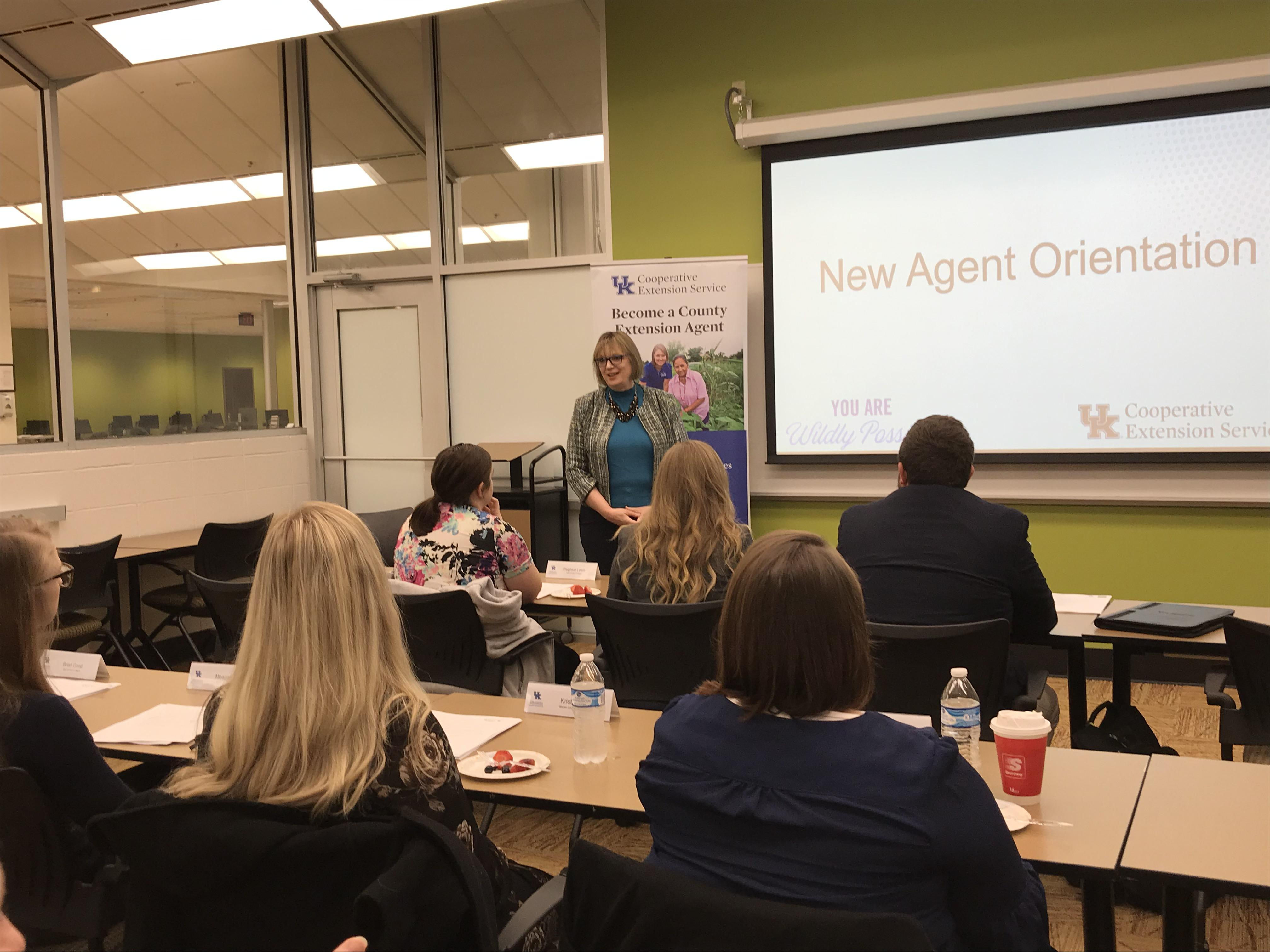 Dr. Laura Stephenson addressing New Agent Orientation.